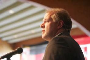 Dr. Andrew B. Denison speaking